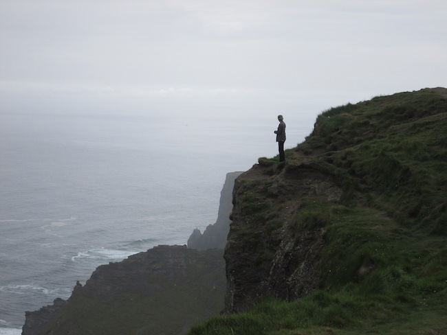 My brother (making my mom nervous!) at the Cliffs of Moher