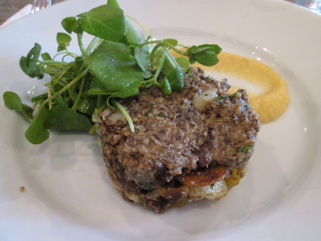 A gourmet plate of Haggis at a trendy restaurant in Edinburgh