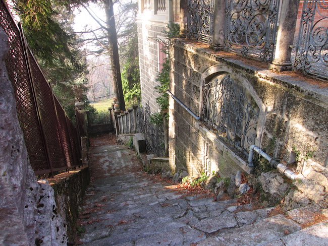 A stone stairway and house built into the hill overlooking Como