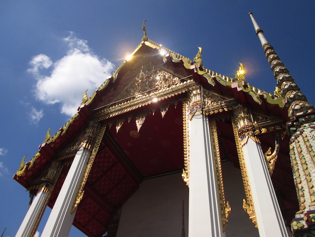 A temple gleaming in the sunlight at Wat Pho