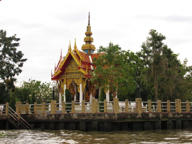 A small temple glimpsed from the water